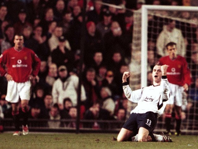Danny Murphy celebrates scoring against Manchester United.