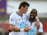 Tottenham's Gareth Bale celebrates with team mate Jermaine Defoe after scoring the opening goal against Swindon in a pre-season friendly on July 16, 2013