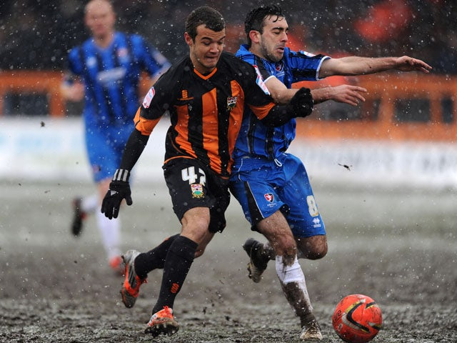 Barnet's Kyle De Silva and Cheltenham's Sam Deering battle for the ball during the League Two match on March 23, 2013