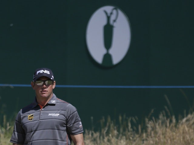 Lee Westwood plays a shot on the 18th at The Open on July 19, 2013
