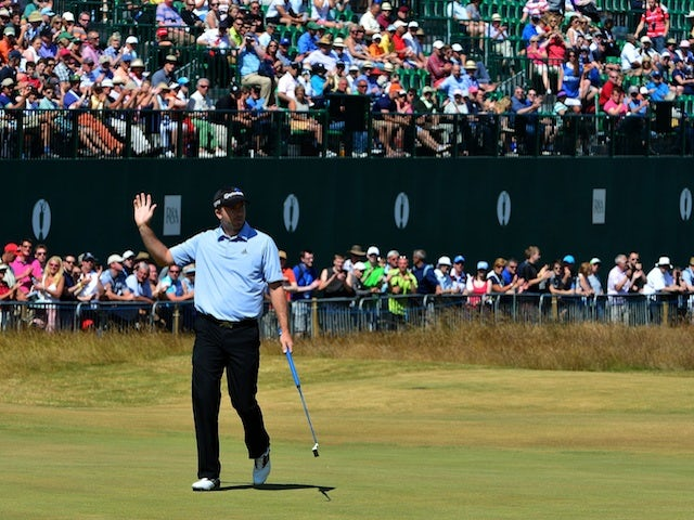 Martin Laird waves to the crowd at The Open on July 19, 2013
