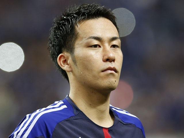Japan's Maya Yoshida poses before their Asian zone Group B qualifying soccer match against Australia on June 4, 2013