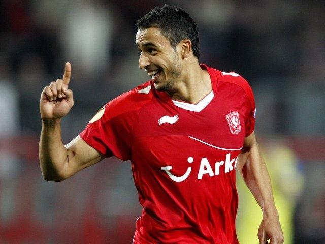 Nacer Chadli celebrates scoring in the Europa League.