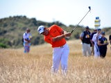 England's Lee Westwood chips out of the rough during day three of the 2013 Open Championship on July 20, 2013