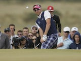 Ian Poulter of England chips onto the 16th green during the final round of the British Open Golf Championship on July 21, 2013