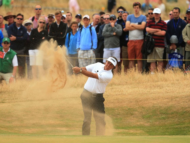 USA's Phil Mickelson plays out of the bunker on the 10th hole during day four of the 2013 Open Championship on July 21, 2013