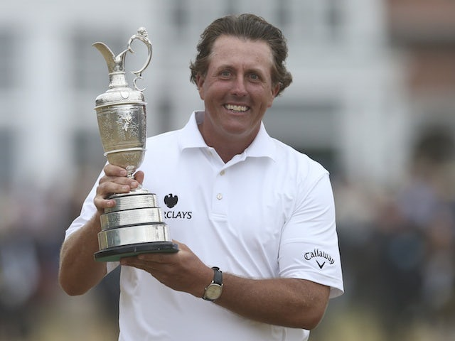 Phil Mickelson celebrates winning The British Open on July 21, 2013