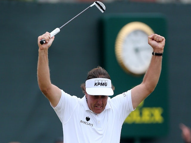 Phil Mickelson celebrates his final putt at The Open on July 21, 2013