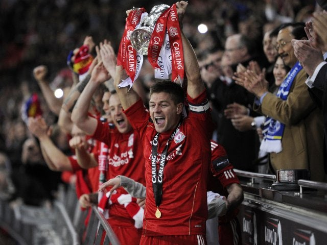 Gerrard lifts the League Cup aloft following Liverpool's win on penalties over Cardiff City in February 2012.