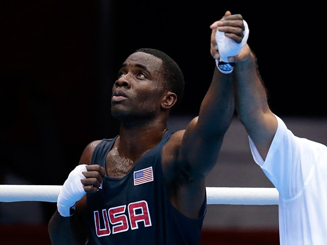 USA's Terrell Gausha is announced as the winner after defeating Armenia's Andranik Hakobyan during the London Olympics on July 28, 2012