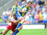 Warrington Wolves' Lee Briers is tackled by Hull Kingston Rovers' Richard Beaumont during the Super League match on July 21, 2013