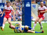 Warrington Wolves' Chris Riley goes over for a try against Hull Kingston Rovers during the Super League match on July 21, 2013
