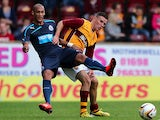 Newcastle United's Yoan Gouffran and Motherwell's Simon Ramsden battle for the ball during a pre-season friendly on July 16, 2013