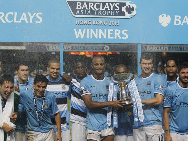 Manchester City players celebrate winning the Asia Cup on July 27, 2013