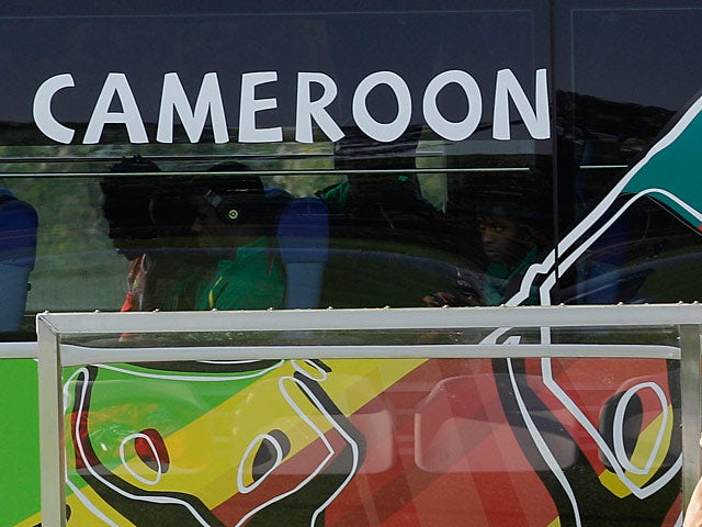 The Cameroon national team arrive by coach to a training session prior to the World Cup in South Africa on June 12, 2010