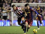Athletic Bilbao's Carlos Gurpegui duels for the ball with Barcelona's Lionel Messi on January 5, 2011