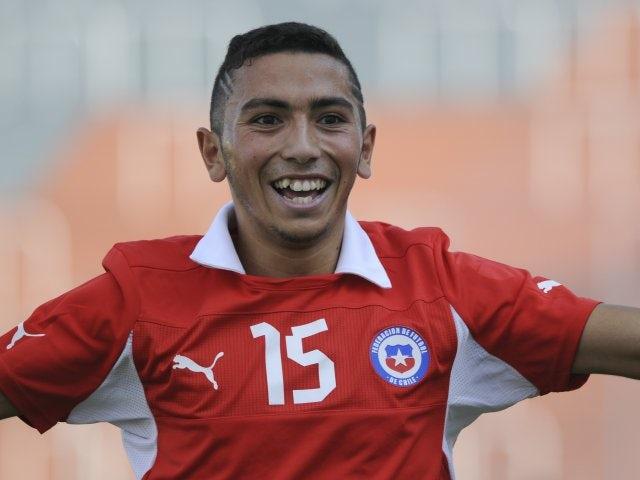 Cristian Cuevas celebrates scoring a goal for Chile.