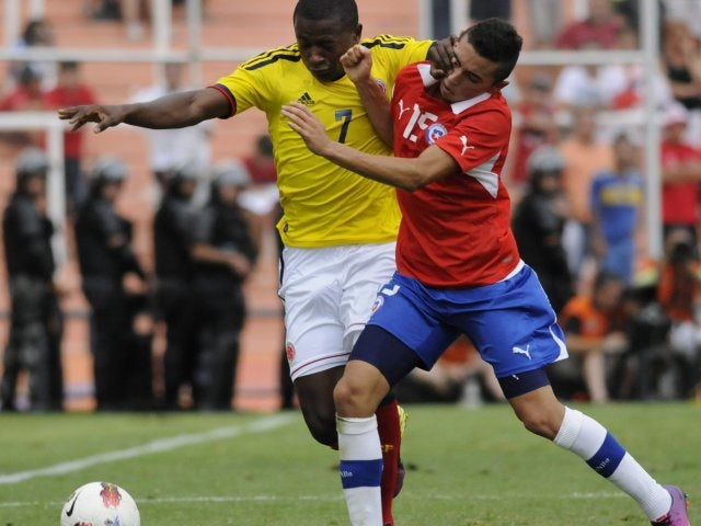 Cristian Cuevas tussles for possession against Colombia.