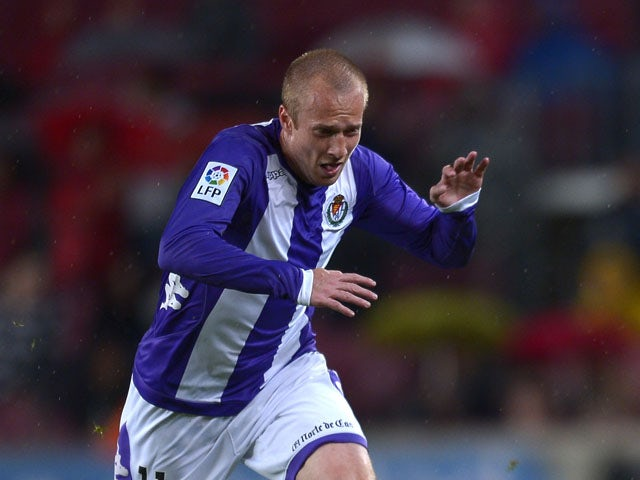 Valladolid's Daniel Larsson runs for the ball during the match against FC Barcelona on May 19, 2013