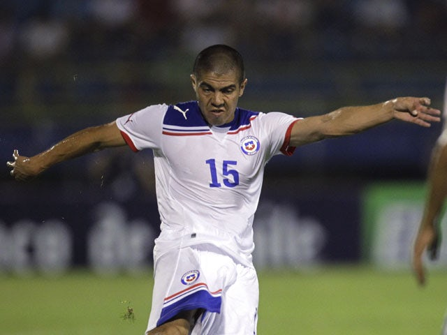 Chile's Francisco Silva plays the ball during a friendly soccer match against Paraguay on February 15, 2012