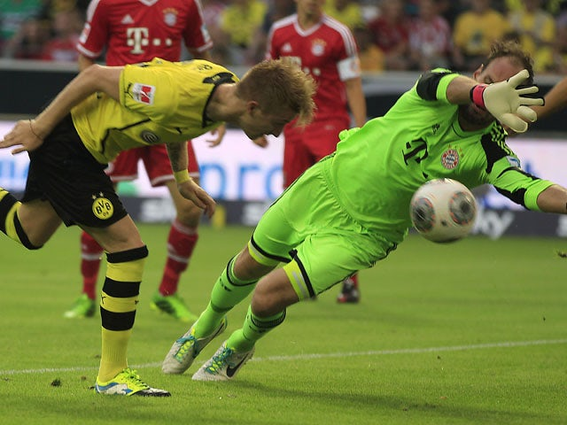 Dortmund's Marco Reus heads the ball to score against Bayern goalkeeper Tom Starke during the Super cup match on July 27, 2013