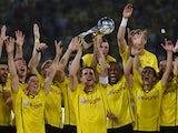 Dortmund's Sebastian Kehl raises the trophy after winning the German Super cup on July 26, 2013