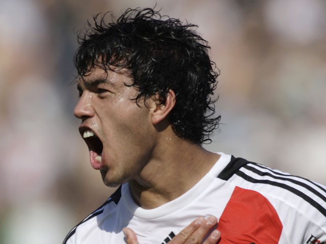 River Plate's Gustavo Cabral celebrates his goal against Chacarita Juniors during an Argentina soccer league game on August 30, 2009