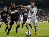 Valladolid's Jesus Rueda vies for the ball with Real Madrid's Cristiano Ronaldo during the La Liga match on May 4, 2013