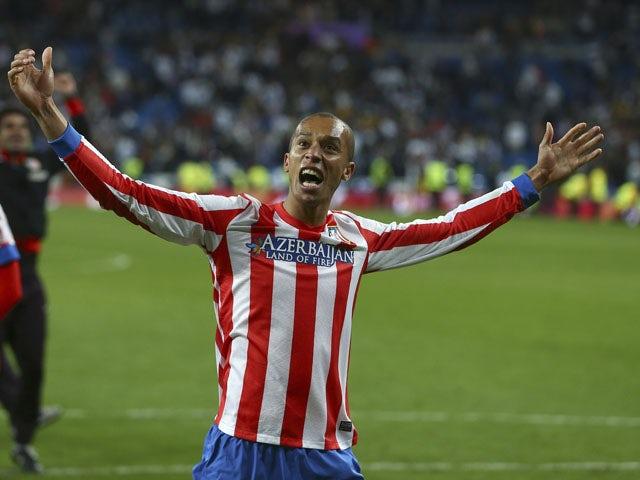 Atletico Madrid's Joao Miranda celebrates winning the Copa del Rey final against Real Madrid on May 17, 2013