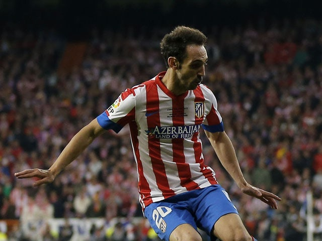 Atletico Madrid's Juanfran during a Copa del Rey match against Real Madrid on May 17, 2013