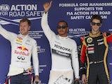 Lewis Hamilton, Sebastian Vettel and Romain Grosjean wave following qualifying for the Hungarian GP on July 27, 2013