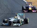 Lewis Hamilton steers his car ahead of Sebastian Vettel during the Hungarian Grand Prix on July 28, 2013