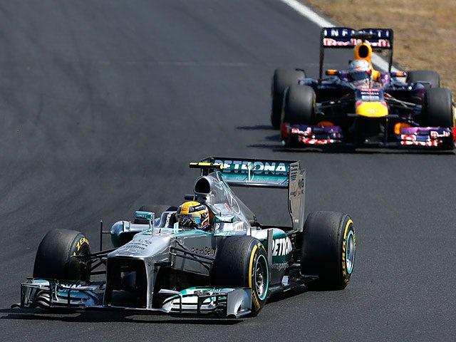 Lewis Hamilton steers his car ahead of Sebastian Vettel during the Hungarian Grand Prix on July 28, 2013
