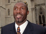 Former British sprinter Linford Christie outside the High Court.