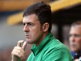 Racing Santander coach Lucas Alcaraz watches his team from the sideline on July 27, 2004