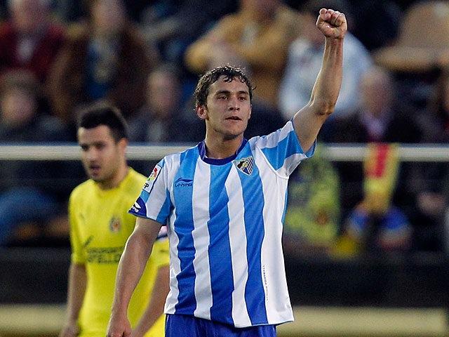 Malaga's Sebastian Fernandez celebrates his goal on February 20, 2011