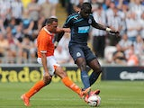 Newcastle United's Moussa Sissoko and Blackpool's Michael Chopra battle for the ball during a friendly match on July 28, 2013