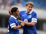 Nikica Jelavic celebrates with Steven Pienaar after a goal versus Blackburn on July 27, 2013