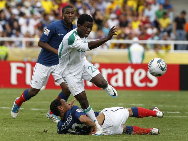 Nigeria's Ramon Azeez runs over France's Francis Coquelin during a U-20 World Cup on August 14, 2011