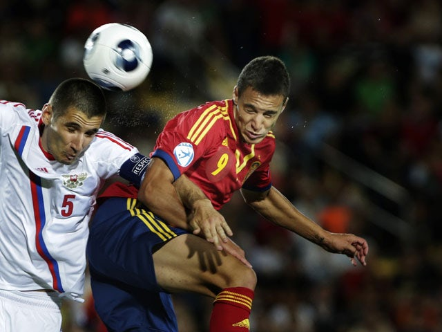 Spain's Rodri Moreno duels for the ball with Russia's Taras Burlak during UEFA European U21 Soccer match on June 6, 2013