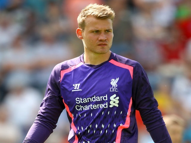 Liverpool goalie Simon Mignolet in action against Preston ...