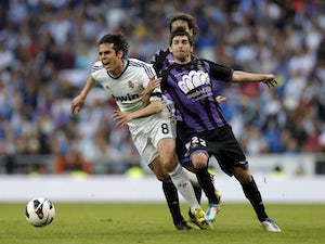 Valladolid's Victor Perez duels with Real Madrid's Kaka during the La Liga match on May 4, 2013