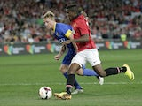 Manchester United Wilfried Zaha, right, controls the ball past Sydney Allstars' Rhyan Grant during a friendly match on July 20, 2013