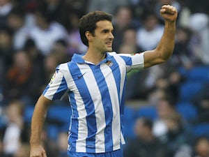 Real Sociedad's Xabi Prieto celebrates scoring against Real Madrid on January 6, 2013