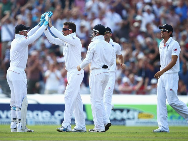 Graeme Swann of England celebrates the wicket of Chris Rogers of Australia with team mates during day one of the 3rd Ashes test on August 1, 2013