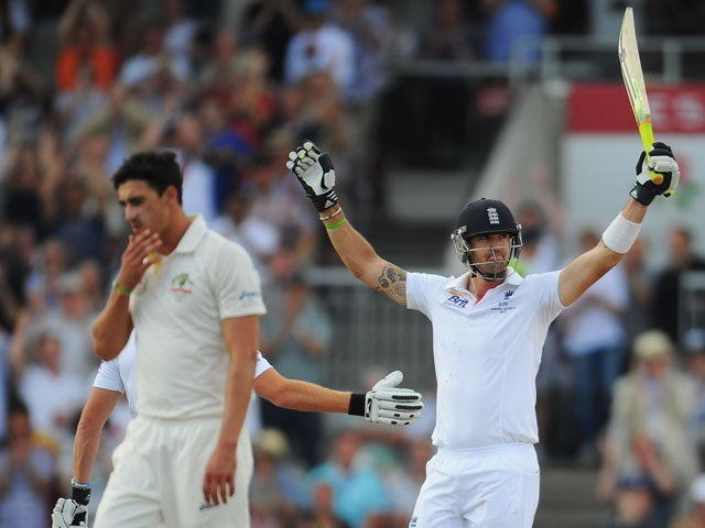 Kevin Pietersen of England celebrates his century as Mitchell Starc of Australia looks dejected during day three of the 3rd Investec Ashes Test match on August 3, 2013