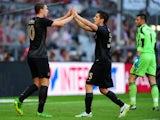 Manchester City's Edin Dzeko celebrates scoring his first goal with team mate Stevan Jovetic on July 31, 2013