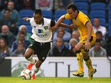Brighton & Hove Albion's David Lopez battles for possession of the ball with Norwich City's Nathan Redmond during the pre-season friendly on July 30, 2013