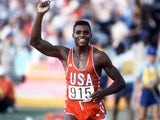 Carl Lewis celebrates winning gold at the 1984 Olympic Games.