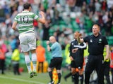 Anthony Stokes of Celtic celebrates scoring his second goal of the day with manager Neil Lennon during the Scottish Premier League game between Celtic and Ross County on August 3, 2013